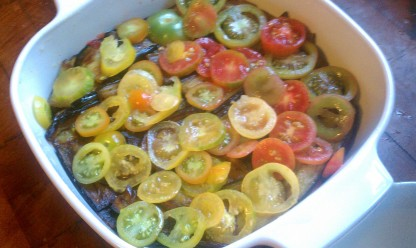 layered with tomatoes and baked.